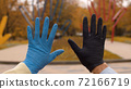 Male and female hands in latex gloves 72166719