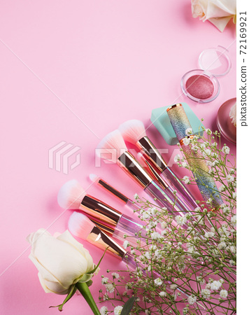 Shiny make up products and accessories on pink 72169921