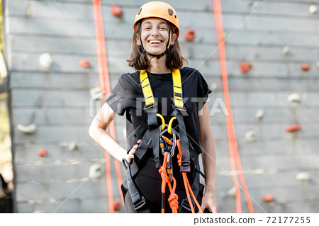 Well equipped woman near the climbing wall 72177255