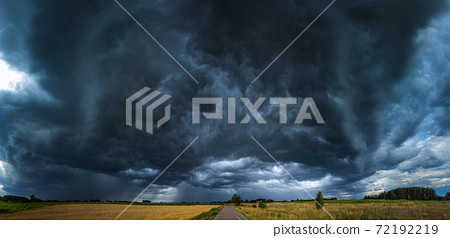 Image of dark Storm whale mouth clouds in the field 72192219