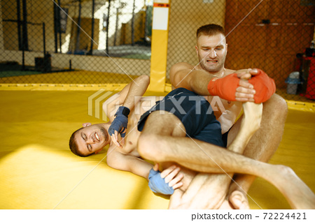 MMA fighter performs leg grab to his opponent 72224421