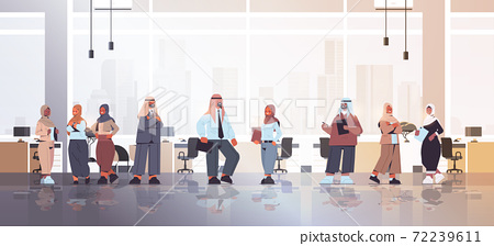 arabic businesspeople discussing during meeting arab business people standing together successful team 72239611