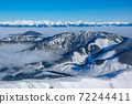 Snow Capped Peaks and Fog in the Valleys. Aerial View 72244411