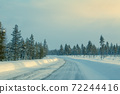 Empty Winter Road Through a Rare Northern Forest 72244416