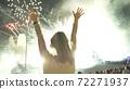 Woman Enjoying Fireworks 72271937