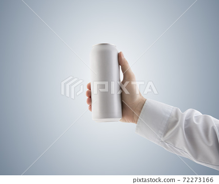 Man holding white blank aluminum can with beverage with clipping path 72273166