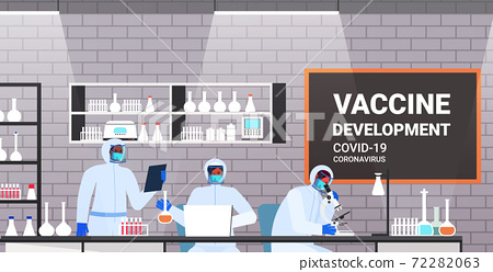 mix race scientists developing vaccine to fight against coronavirus researchers team working in medical lab vaccine development concept 72282063