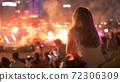 Woman Enjoys Concert 72306309