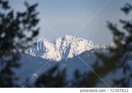 Snow-covered rocky mountain British Columbia Canada 72307622