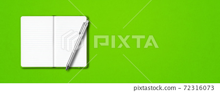 Green open notebook with a pen isolated on colorful background. Horizontal banner 72316073