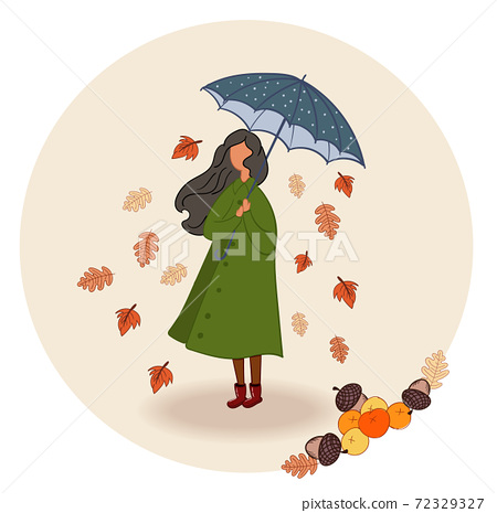 Black haired woman in green coat and red boots holind a blue and white umbrella while leaves fall 72329327