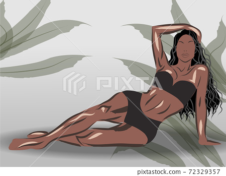Sporty woman laying dressed in black sport underwear. Tropical leaves background 72329357