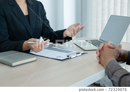 Business people hold a resume and talk to job applicants for job interviews about careers and Her personal history in the company. Recruitment concepts 72329878