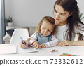 Tutor with litthe girl studying at home 72332612