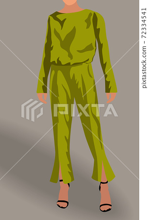 Woman dressed in green blouse, pants and black high heels 72334541
