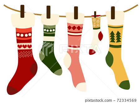 Composition of woolen christmas themed socks hung with clothespin on a wire 72334569