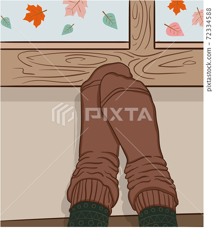 Composition of feet in brown socks held against a window while leaves are falling outside 72334588