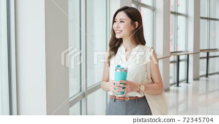 businesswoman use smart phone 72345704