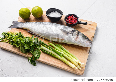 Whole sea bass with spices and herbs ingredients 72349340
