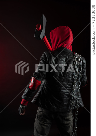 a man in a Balaclava and hoodie with an axe the image of a Protestant 72353639