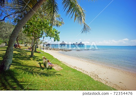 The island closest to heaven Noumea coast and palm trees 72354476