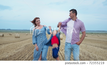 parenting, mother and father hold their son hands and throw up 72355219