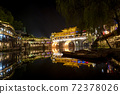 View of illuminated at night riverside houses in ancient town of Fenghuang known as Phoenix, China 72378026