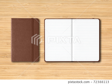 Dark leather closed and open lined notebooks on wooden background 72388113
