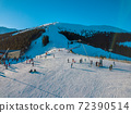 Skiers on the Winter Ski Slope on a Sunny Day. Aerial View 72390514