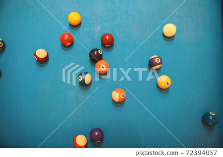 many billiard ball on blue pool table 72394057