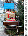 Wooden sledge from the front with presents 72399894