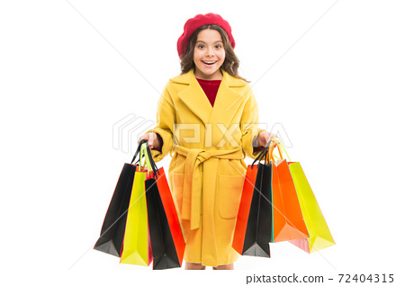 Girl hold shopping bags. Model with long hair on white  72404315