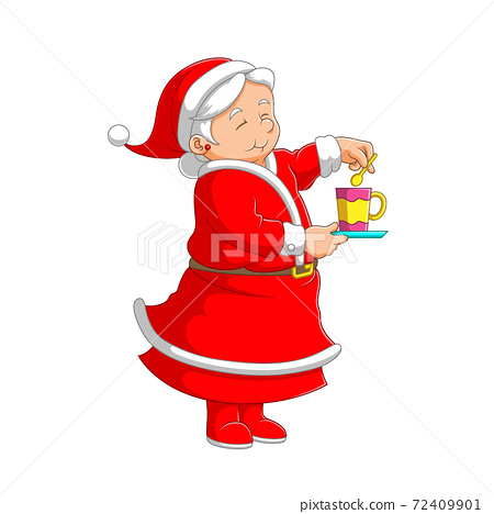 The grandmother using the red costume standing and making a cup of tea 72409901