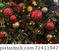 horizontal closeup Christmas flowers and tree with shiny  decorations and lights 72411947
