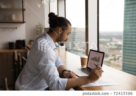 African American male worker work on laptop in office 72415586