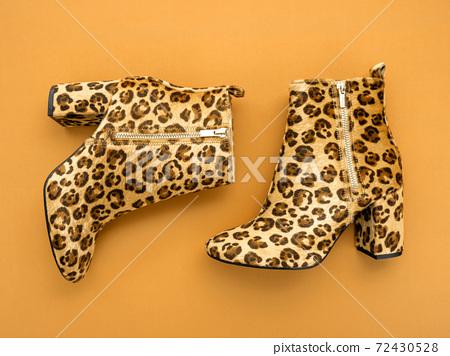 Stylish boots on trendy marigold background. 72430528