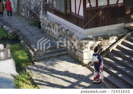 A woman in a kimono standing in Hachimanbori, Omihachiman, Shiga Prefecture 72431638
