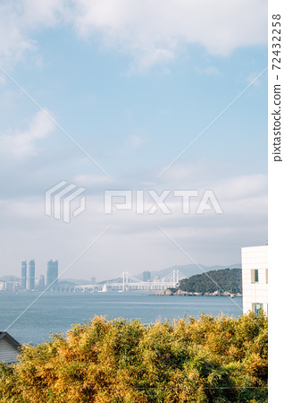 View of Gwangan bridge and blue ocean from Haeundae Dalmaji-gil Moontan Road in Busan, Korea 72432258