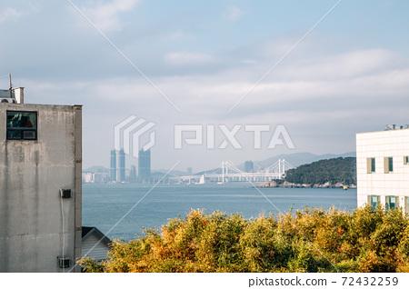 View of Gwangan bridge and blue ocean from Haeundae Dalmaji-gil Moontan Road in Busan, Korea 72432259