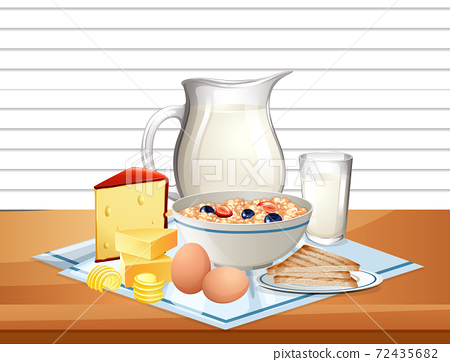 Breakfast cereal in bowl with jar of milk in a group on the tabl 72435682