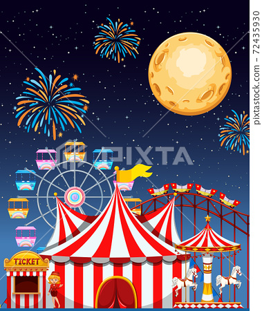 Amusement park scene at night with fireworks and 72435930