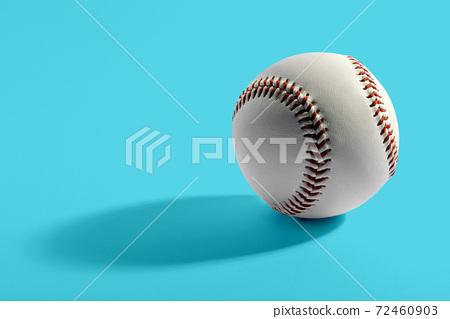 Baseball with long shadow on blue background 72460903