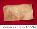 Old paper banner on red cardboard. 72462268