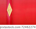 Red wooden gate with golden details 72462274