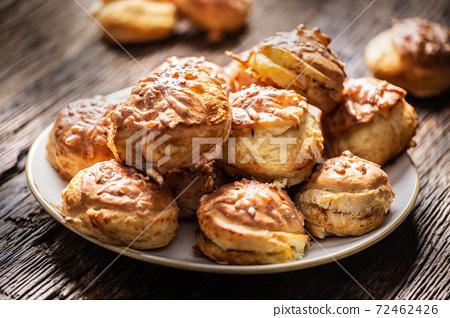 Slovak and Hungarian pagace or pagacsa buns freshly baked and served on a plate 72462426