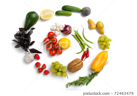 Vegetables and fruits swirl, white background 72463479