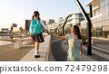 Young mother with little daughter in uniform going to school at morning 72479298