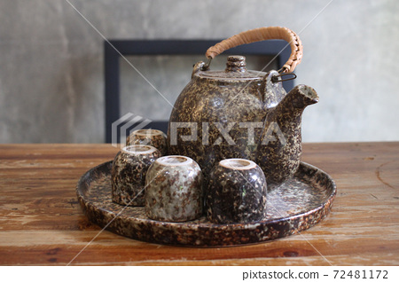Homemade warm healthy organic freshness tea in teapot and small cups, advertisement backgrounds at cafe Japanese home stay  72481172