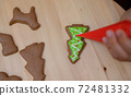 Homemade Xmas cookie for Christmas and Happy New Year. Cooking gingerbread with friend and Family on winter holiday at home. 72481332