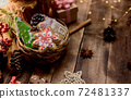 Homemade Xmas cookie for Christmas and Happy New Year. Gingerbread on wood background for winter holiday. 72481337